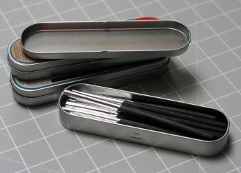 Charcoal in a tin